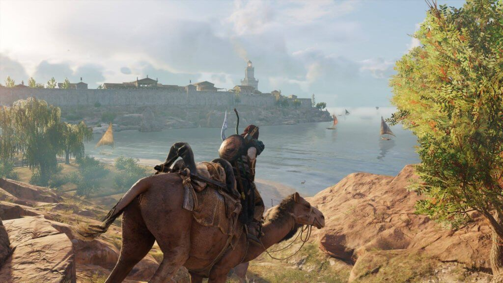 Assassin Creed Origins gameplay: Bayek riding camels on a mountain looking to the ocean