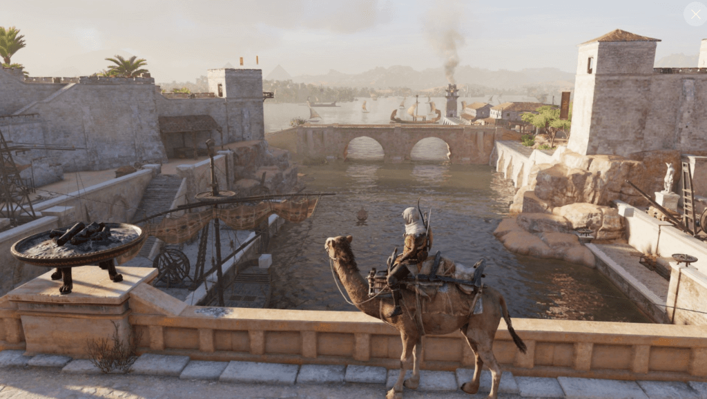 Assassin Creed Origins gameplay: Bayek on a camel in a great view of the city
